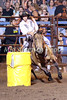 Barrel racer Tasia Behnke from Muscatine rounds a barrel during the 10th Annual Wapello PRCA Rodeo Saturday, July 14, 2018.
