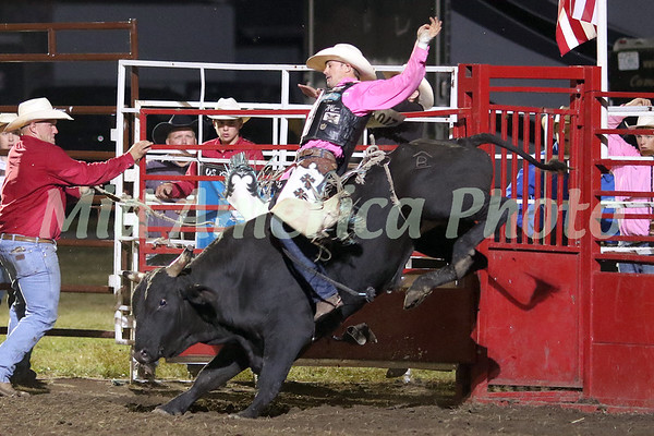 Jay Morrow, from Wayland, makes a valiant attempt to stay on his bull during the bull riding event at the 10th Annual Wapello PRCA Rodeo Saturday, July 14, 2018.