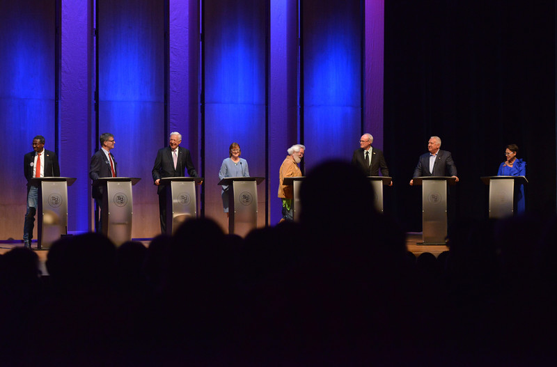 Justin Sheely | The Sheridan Press<br /> Candidates, from left, Taylor Haynes, Mark Gordon, Foster Friess, Mary Throne, Rex Wilde, Bill Dahlin, Sam Galeotos and Harriet Hageman react as Friess makes a remark about not being addressed by his first name during the 2018 Wyoming gubernatorial debate at the Whitney Center for the Arts Tuesday, June 26, 2018. The debated included two democrats and six republican candidates for Wyoming governor. The event was hosted by The Sheridan Press with Sheridan College, Sheridan County Chamber of Commerce and Wyoming PBS.
