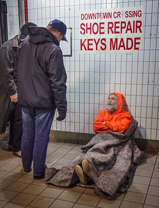 Mayor Walsh speaks to a homeless man at the Downtown Crossing T station