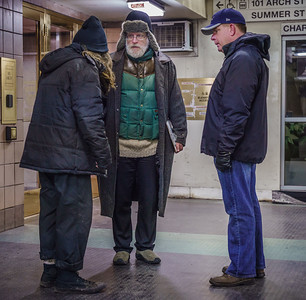 Mayor Marty Walsh (left) and Jim Greene of the city's Emergency Shelter Commission speak to a homeless man near Arch Street