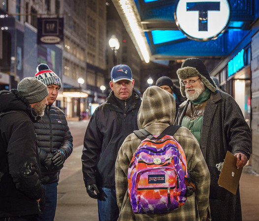 Mayor Marty Walsh (left) and Jim Greene of the city's Emergency Shelter Commission speak to formerly homeless woman (with backpack) at Downtown Crossing