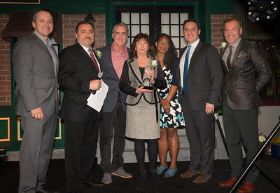 Pamela Donnaruma, publisher of the Boston Post-Gazette was honored for her community support. (L-R) Rep. Aaron Michlewitz, TONE co-founder Donato Frattaroli, NESN's Billy Costa, Pam Donnaruma, Councilor Lydia Edwards, Sen. Joe Boncore and NEW Health CEO James Luisi.