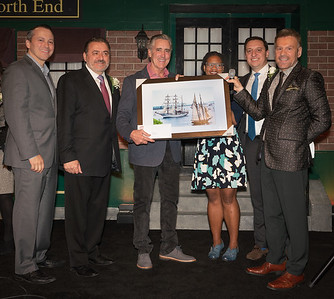 Billy Costa of NESN's Dining Playbook is presented with a Tall Ships photograph for his support as TONE emcee. (L-R) Rep. Aaron Michlewitz, Donato Frattaroli, Billy Costa, Councilor Lydia Edwards, Sen. Joe Boncore and James Luisi.