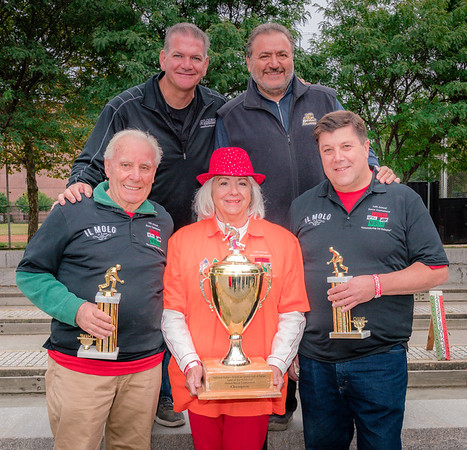 First place goes to Matteo Norcia (left) and Nino Rinaldi (right) with Yvonne Balsamo holding the tournament trophy representing honoroee Salvatore Balsamo with organizers Chris Zizza (upper left) and Donato Frattroli (upper right)