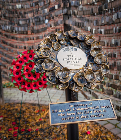 A bronze poppy wreath plaque honors servicepersons from the British Commonwealth that have died.
