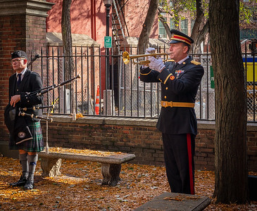 Taps was played during the ceremony for the plaque installation at the Old North Memorial Garden