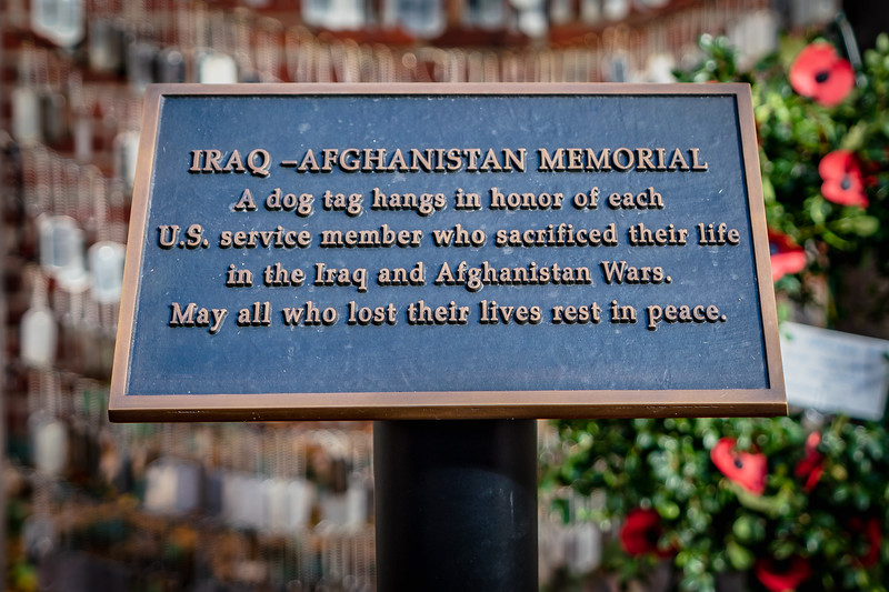 A plaque describes the dog tags as representing each American serviceperson who lost their life in the wars (the count currently stands at 6,970).