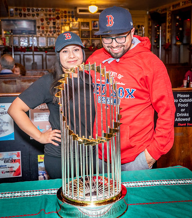 Dressed to pose with the 2018 Boston Red Sox World Series Trophy