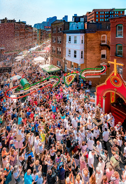Confetti fills Endicott Street in Boston's North End for the 99th St. Anthony's Feast