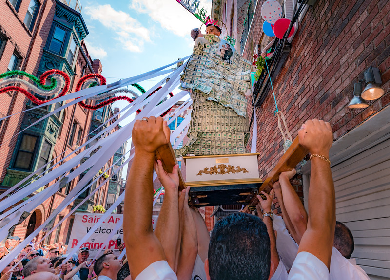 Lifting the statue of Saint Anthony for second floor devotions