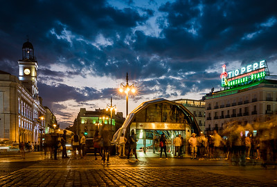 Clouds over the bustling Puerta del Sol in Madrid, Spain