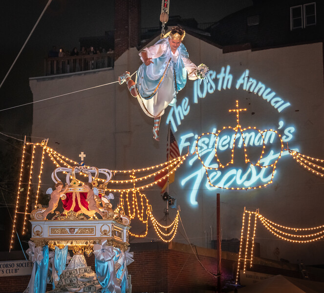 Flying Angel Sophia Fialkosky soars over the 108th Fisherman's Feast