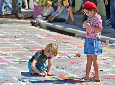 Artists paint the streets Sunday afternoon during the 24th annual Street Painting Festival in Lake Worth. (Photo by Tim Stepien / Palm Beach Post)
