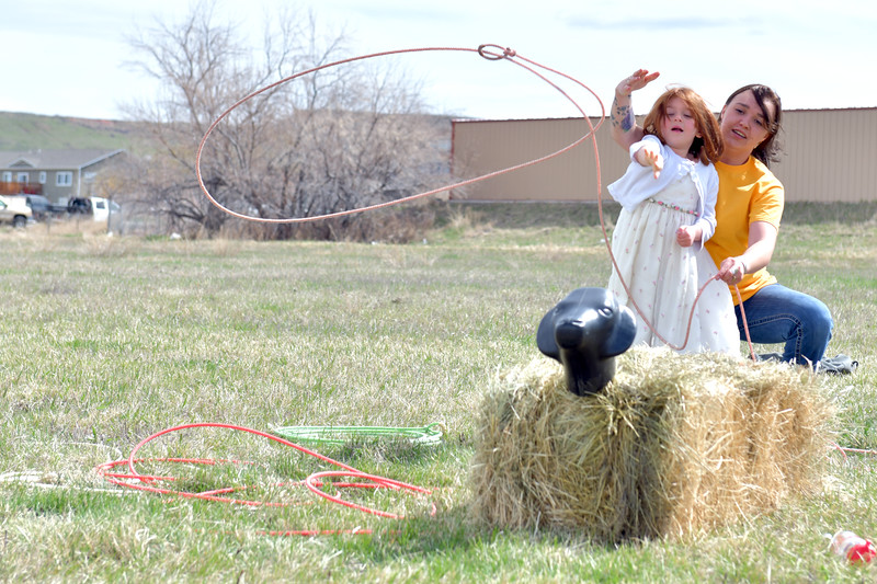 Matthew Gaston | The Sheridan Press<br>Archer Toth, 6, ropes a sheep with help from BWC volunteer Turner Schroth during the 2019 BWC Community Easter Carnival &amp; Egg Hunt Saturday, April 20, 2019.
