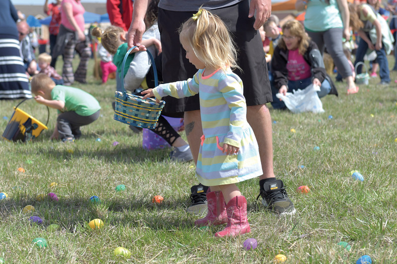 Matthew Gaston | The Sheridan Press<br>Anna Starr, 1, leisurely collects Easter eggs during the 2019 BWC Community Easter Carnival &amp; Egg Hunt at the Bethesda Worship Center Saturday, April 22, 2019.