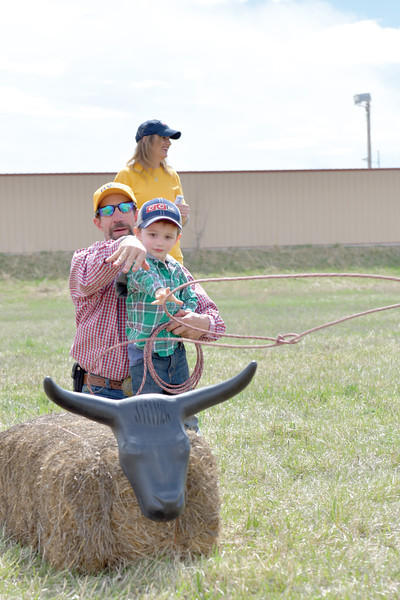 Matthew Gaston | The Sheridan Press<br>Lee Whilley instructs Emmitt Garriffa, 3, in the fine art of calf roping during the 2019 BWC Community Easter Carnival &amp; Egg Hunt Saturday, April 20, 2019.