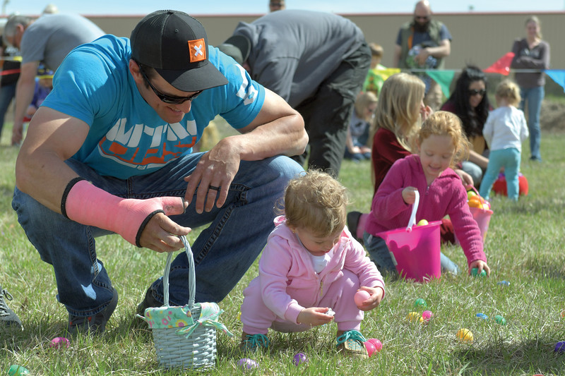 Matthew Gaston | The Sheridan Press<br>Sam Davis, left, carries an Easter basket for his 18-month-old daughter Lani Davis during the Easter egg hunt at the Bethesda Worship Center Saturday, April 20, 2019.