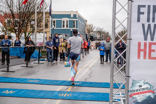 "Runners gathered at the Bentonville Square for a ""short"" 5k or 13.1 mile run throughout the streets of Bentonville, concluding with the dreaded Crystal Bridges Hill."