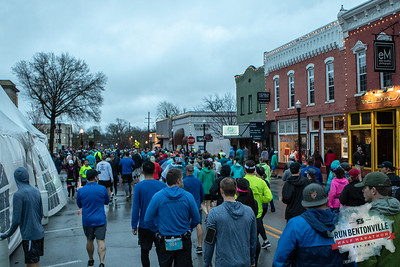 """Runners gathered at the Bentonville Square for a """"short"""" 5k or 13.1 mile run throughout the streets of Bentonville, concluding with the dreaded Crystal Bridges Hill."""