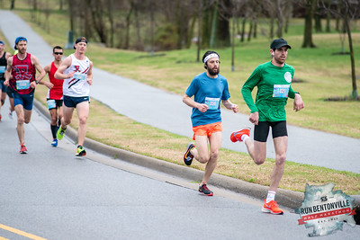 """Runners gathered at the Bentonville Square for a """"short"""" 5k or 13.1 mile run throughout the streets of Bentonville, concluding with the dreaded Crystal Bridges Hill. At miles 3-4 they ran through Memorial Park."""