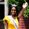 Don Knight | The Herald Bulletin<br /> Miss Kiwanis Balloon Fest A'Niyah Birdsong waves to the crowd during the Anderson Black Expo parade on Saturday.
