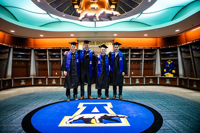 Graduating members of the Alaska Nanooks men's ice hockey team visit the locker room at the Carlson Center in their academic regalia before the University of Alaska Fairbanks commencement ceremony, which is held at the center, on May 4, 2019.