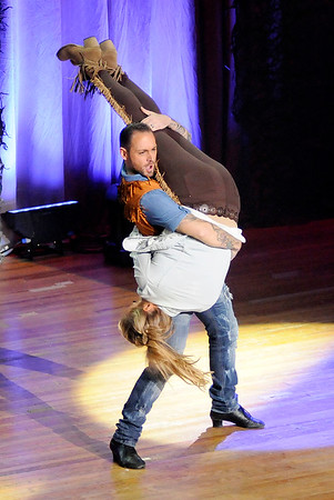 Don Knight   The Herald Bulletin<br /> Dani Fulvi lifts Anna Foster and uses her as an air guitar during Dancing Like the Stars at the Paramount on Saturday.