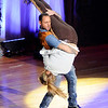 Don Knight | The Herald Bulletin<br /> Dani Fulvi lifts Anna Foster and uses her as an air guitar during Dancing Like the Stars at the Paramount on Saturday.