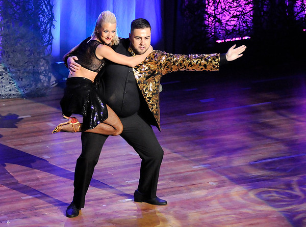 Don Knight | The Herald Bulletin<br /> Kathleen Ilo jumps into the arms of Joel Hersberger at the end of their performance during Dancing Like the Stars at the Paramount on Saturday.