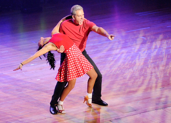 Don Knight | The Herald Bulletin<br /> Jeff Davis points to the audience as he dances the Jive with Veronica Criscione during Dancing Like the Stars at the Paramount on Saturday.