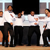 Don Knight | The Herald Bulletin<br /> The Beaus react as Marcus Cullum performs his dance during the Annual Debutante Cotillion Beautillion Militaire's Scholarship Ball at Park Place Church of God on Saturday.