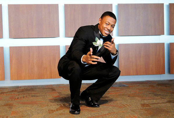 Don Knight | The Herald Bulletin<br /> Tyler Mangrum strikes a pose as he is introduced during the Annual Debutante Cotillion Beautillion Militaire's Scholarship Ball at Park Place Church of God on Saturday.