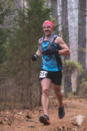 On a cloudy, cold December morning the Back 40 Trail race kicked off with day one consisting of a 5k, 13 mile, 20 mile, or 40 mile run throughout the Back 40 trail system in Bella Vista, AR.