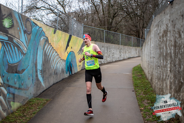 """Runners gathered at the Bentonville Square for a """"short"""" 5k or 13.1 mile run throughout the streets of Bentonville, concluding with the dreaded Crystal Bridges Hill. Around mile 10, after passing the dog park, runners followed the Razorback Greenway toward Slaughter Pen."""