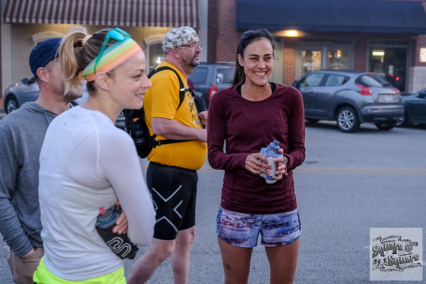 """The 7th Annual Unofficial Square to Square Marathon kicked off with the """"Sermon on the Truck"""" at Bentonville Square.  Mike Rush explained the course, or lack there of, and the fun but unofficial nature of the race.  Everyone then ran, meeting up at the Fayetteville Square."""