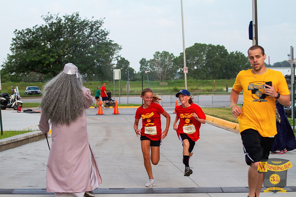 On a blistering hot Saturday morning, runners and walkers gathered at the Hyvee Arena in Kansas City for the Wizarding Run consisting of a 1 mile fun run, 5k, vendors and costumes.