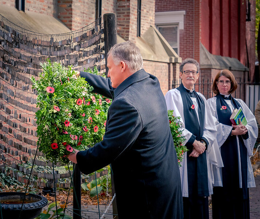 Rembrance Day at the Old North Memorial Garden. Richard Schofield, President of the British Officers Club, lays the wreath with Vicar Stephen T. Ayres and Assoc. Vicar Ellie Terry