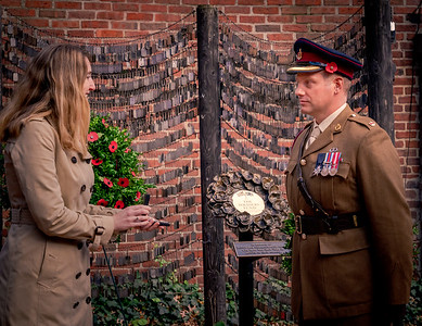Major Michael Court receives medal from British Consul General Harriet Cross