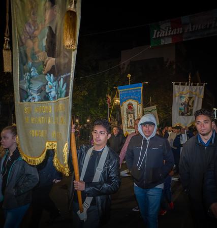 Michael Bonetti carrys for St. Anthony Society