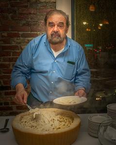 Host Filippo Frattaroli cooks pasta in a cheese wheel