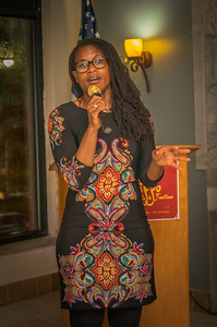 District 1 City Councilor Lydia Edwards talks at the Columbus Day reception.