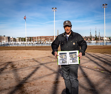 UMass Boston Research Scientist John Steinberg displays the exact location of the molasses tank foundation, 20 inches underground the infield at Langone Park