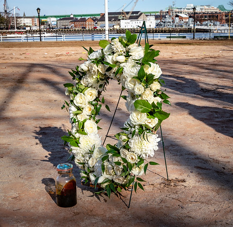 A jar of molasses with a wreath in commemoration of the tragegy
