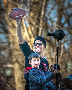 Patriots Quarterback Tom Brady with his son in the Super Bowl LIII victory parade