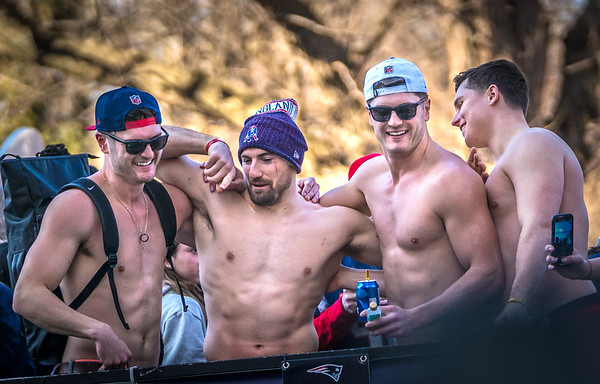 Sans shirts, Chris Hogan, Rex Burkhead and other New England Patriots players celebrate at the rolling rally other New England Patriots players celebrate at the rolling rally