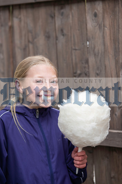 Alaina Keller takes a bite out of her maple-flavored cotton candy.