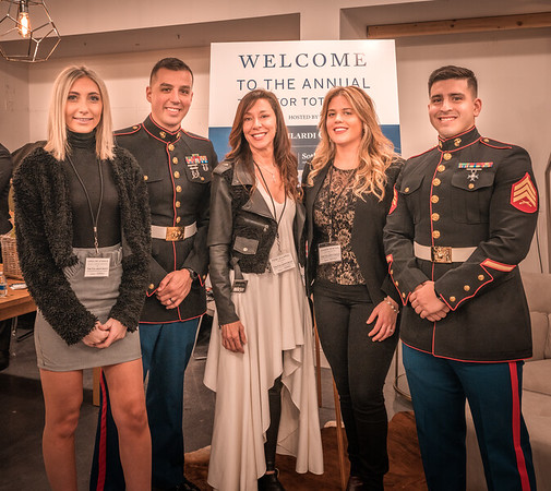 Toni, Lauren and Caroline of the Gilardi Group join with the US Marines for Toys for Tots fundraising