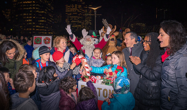 Flipping the switch for the trellis lighting at Columbus Park