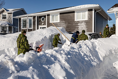 Canadian Reserves 37 CER Combat Engineers Squadron do snow clearing for Mrs. Good on Hagen Place.